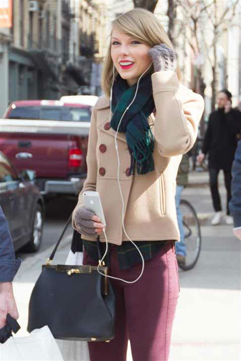 "<div class=""meta image-caption""><div class=""origin-logo origin-image ""><span></span></div><span class=""caption-text"">Taylor Swift appears in New York City while shopping on March 27, 2014. The singer looked adorable in a beige pea coat, maroon skinny jeans, ankle-high boots and a plaid scarf that perfectly matched her flannel shirt. (Freddie Baez / startraksphoto.com)</span></div>"