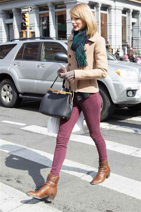 "<div class=""meta ""><span class=""caption-text "">Taylor Swift appears in New York City while shopping on March 27, 2014. The singer looked adorable in a beige pea coat, maroon skinny jeans, ankle-high boots and a plaid scarf that perfectly matched her flannel shirt. (Freddie Baez / startraksphoto.com)</span></div>"