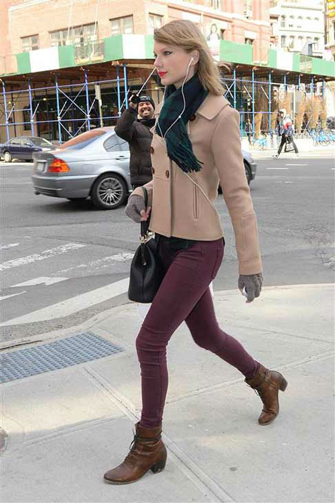 Taylor Swift appears in New York City while shopping on March 27, 2014. The singer looked adorable in a beige pea coat, maroon skinny jeans, ankle-high boots and a plaid scarf that perfectly matched her flannel shirt. <span class=meta>(247PAPS.TV &#47; startraksphoto.com)</span>