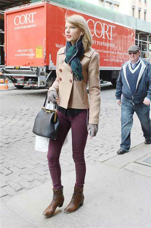"<div class=""meta ""><span class=""caption-text "">Taylor Swift appears in New York City while shopping on March 27, 2014. The singer looked adorable in a beige pea coat, maroon skinny jeans, ankle-high boots and a plaid scarf that perfectly matched her flannel shirt. (247PAPS.TV / startraksphoto.com)</span></div>"