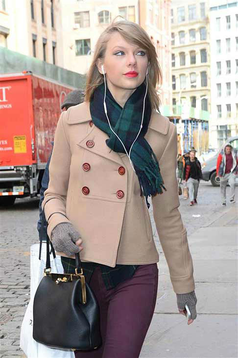"<div class=""meta image-caption""><div class=""origin-logo origin-image ""><span></span></div><span class=""caption-text"">Taylor Swift appears in New York City while shopping on March 27, 2014. The singer looked adorable in a beige pea coat, maroon skinny jeans, ankle-high boots and a plaid scarf that perfectly matched her flannel shirt. (247PAPS.TV / startraksphoto.com)</span></div>"