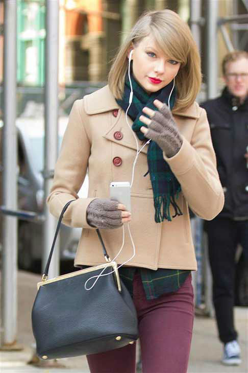 Taylor Swift appears in New York City while shopping on March 27, 2014. The singer looked adorable in a beige pea coat, maroon skinny jeans, ankle-high boots and a plaid scarf that perfectly matched her flannel shirt. <span class=meta>(Freddie Baez &#47; startraksphoto.com)</span>