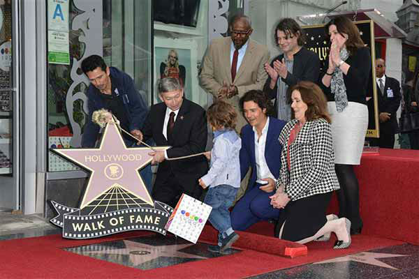 "<div class=""meta image-caption""><div class=""origin-logo origin-image ""><span></span></div><span class=""caption-text"">Orlando Bloom receives a star on the Hollywood Walk of Fame on April 2, 2014. He brought along his son, Flynn, and thanked his estranged wife, Miranda Kerr, during the ceremony. (Tony Dimaio / startraksphoto.com)</span></div>"