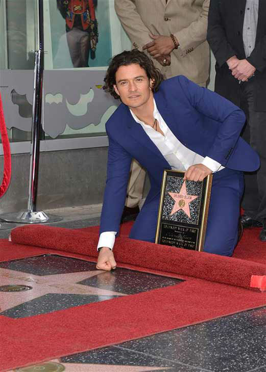 Orlando Bloom receives a star on the Hollywood Walk of Fame on April 2, 2014. He brought along his son, Flynn, and thanked his estranged wife, Miranda Kerr, during the ceremony. <span class=meta>(Tony Dimaio &#47; startraksphoto.com)</span>