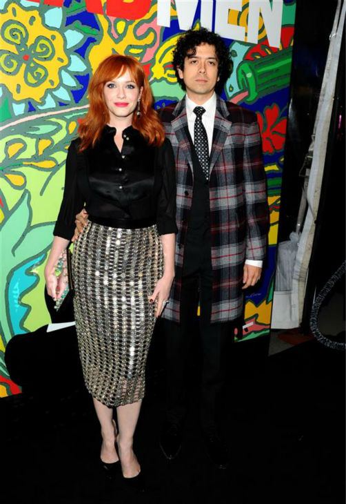 Christina Hendricks &#40;Joan Harris&#41; and husband and actor Geoffrey Arend appear at the season 7 premiere of AMC&#39;s &#39;Mad Men&#39; in Hollywood, California on April 2, 2014. She is wearing a metallic Wes Gordon Spring 2014 skirt. <span class=meta>(Daniel Robertson &#47; Startraksphoto.com)</span>