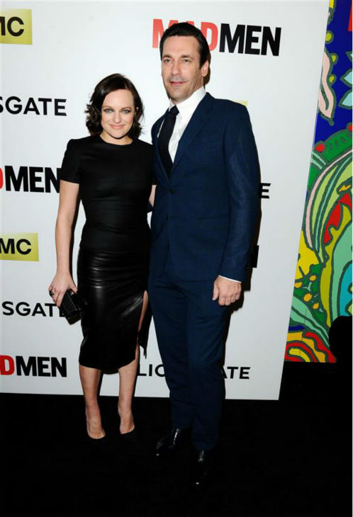 "<div class=""meta image-caption""><div class=""origin-logo origin-image ""><span></span></div><span class=""caption-text"">Elisabeth Moss (Peggy Olson) and Jon Hamm (Don Draper) appear at the season 7 premiere of AMC's 'Mad Men' in Hollywood, California on April 2, 2014. Moss is wearing a black, leather Alexander McQueen pencil dress. (Daniel Robertson / Startraksphoto.com)</span></div>"