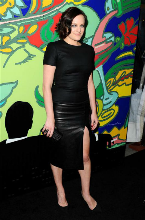Elisabeth Moss &#40;Peggy Olson&#41; appears at the season 7 premiere of AMC&#39;s &#39;Mad Men&#39; in Hollywood, California on April 2, 2014. She is wearing a black, leather Alexander McQueen pencil dress. <span class=meta>(Daniel Robertson &#47; Startraksphoto.com)</span>