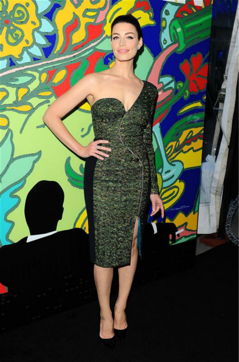 "<div class=""meta image-caption""><div class=""origin-logo origin-image ""><span></span></div><span class=""caption-text"">Jessica Pare (Megan Draper) appears at the season 7 premiere of AMC's 'Mad Men' in Hollywood, California on April 2, 2014. She is wearing a green, one-shoulder Antonio Berardi Pre-Fall 2014 dress. (Daniel Robertson / Startraksphoto.com)</span></div>"