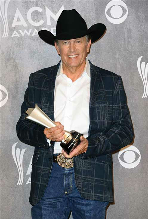 "<div class=""meta image-caption""><div class=""origin-logo origin-image ""><span></span></div><span class=""caption-text"">George Strait appears backstage at the 49th annual Academy of Country Music Awards in Las Vegas on April 6, 2014. He took home an award for Entertainer of the Year. (Sara De Boer / startraksphoto.com)</span></div>"