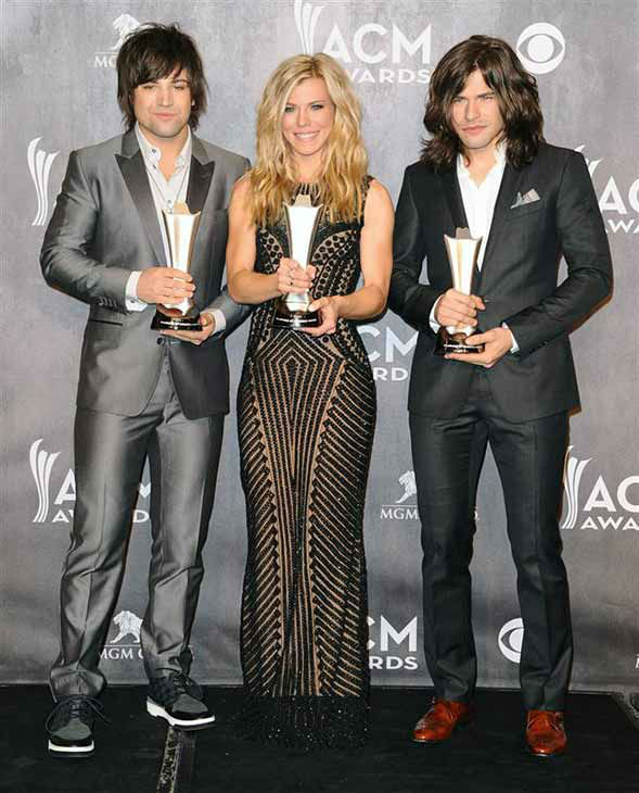 The Band Perry, consisting of members Neil, Kimberly and Reid Perry, appear backstage at the 49th annual Academy of Country Music Awards in Las Vegas on April 6, 2014. They took home an award for Vocal Group of the Year. <span class=meta>(Sara De Boer &#47; startraksphoto.com)</span>