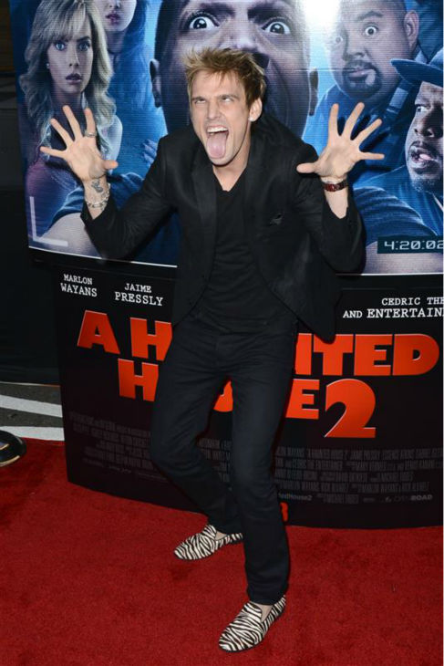"<div class=""meta ""><span class=""caption-text "">Aaron Carner attempts to scare the masses at the premiere of 'A Haunted House 2' in Los Angeles on April 16, 2014. (Tony DiMaio / Startraksphoto.com)</span></div>"