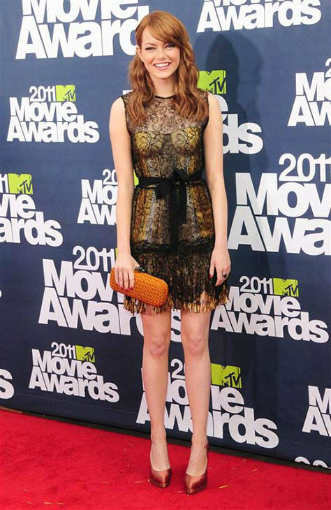 "<div class=""meta ""><span class=""caption-text "">The time she looked adorable in lace at the 2011 MTV Movie Awards on June 5, 2011. (Kyle Rover/startraksphoto.com)</span></div>"