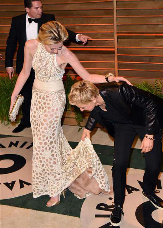 We love Ellen DeGeneres because she&#39;s got your back in the wardrobe department, as evidenced in this photo with wife Portia De Rossi, who had difficulty with the train of her dress at the 2014 Vanity Fair Oscar party in Los Angeles on March 2, 2014. <span class=meta>(Tony Dimaio &#47; startraksphoto.com)</span>