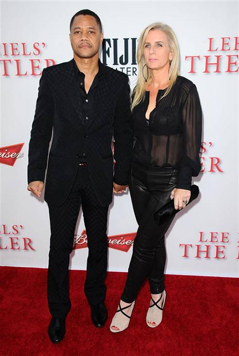 Cuba Gooding Jr. and Sara Kapfer appear at the Los Angeles premiere of the movie 'The Butler' on Aug. 12, 2013.