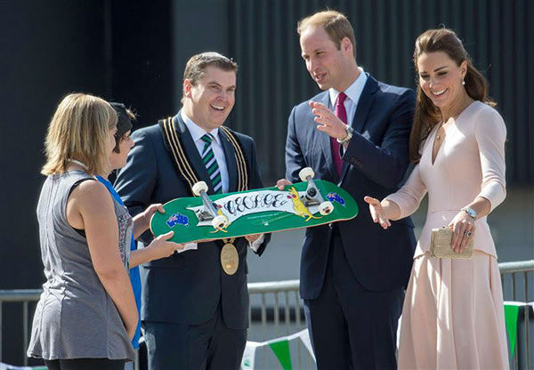 Prince William and Kate Middleton, aka Catherine, Duchess of Cambridge, are presented with a skateboard for George at the skate park of Elizabeth in Australia on April 23, 2014. <span class=meta>(Rex Features&#47;Startraksphoto.com)</span>