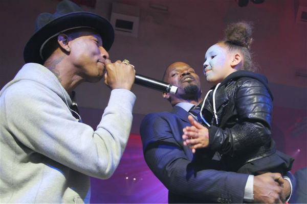 Singer Pharrell Williams, Jamie Foxx and daughter Annalise Bishop, 4, appear on stage at an after party for the premiere of &#39;The Amazing Spider-Man 2&#39; in New York on April 24, 2014. Williams&#39; music is featured on the movie&#39;s soundtrack. Foxx plays the villain Electro in the film. <span class=meta>(Dave Allocca &#47; Startraksphoto.com)</span>
