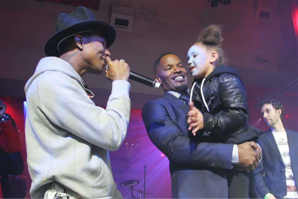 "<div class=""meta image-caption""><div class=""origin-logo origin-image ""><span></span></div><span class=""caption-text"">Singer Pharrell Williams, Jamie Foxx and daughter Annalise Bishop, 4, appear on stage at an after party for the premiere of 'The Amazing Spider-Man 2' in New York on April 24, 2014. Williams' music is featured on the movie's soundtrack. Foxx plays the villain Electro in the film. (Dave Allocca / Startraksphoto.com)</span></div>"