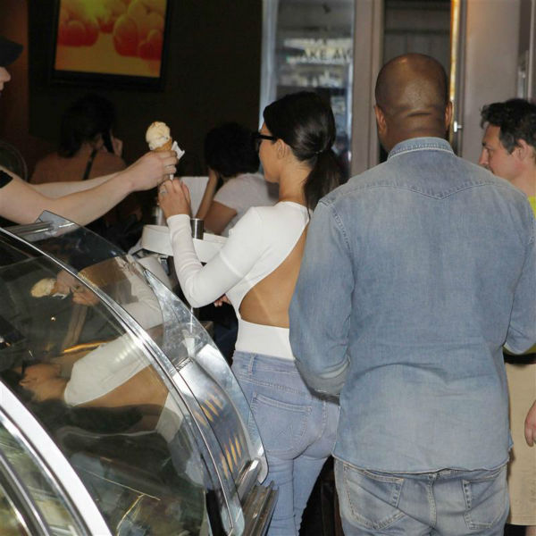 "<div class=""meta image-caption""><div class=""origin-logo origin-image ""><span></span></div><span class=""caption-text"">Kim Kardashian and Kanye West order ice cream at a Haagen Dazs shop in Paris on May 18, 2014. (Beretta / Sims / REX / Startraksphoto.com)</span></div>"