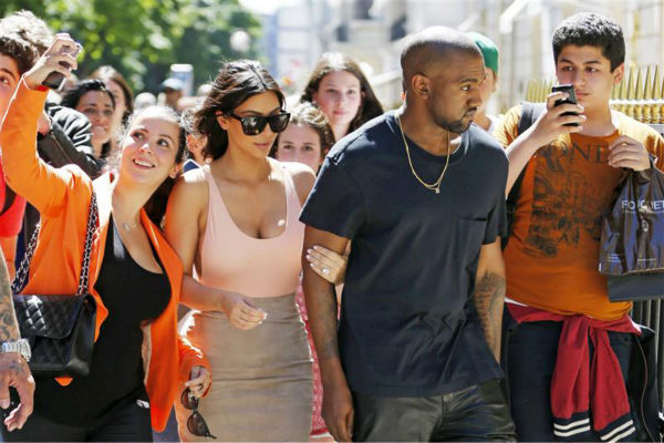 Kim Kardashian and Kanye West go shopping in Paris on May 19, 2014. Fans are seen following them. Many snapped selfies and other photos. <span class=meta>(Beretta &#47; Sims &#47; REX &#47; Startraksphoto.com)</span>