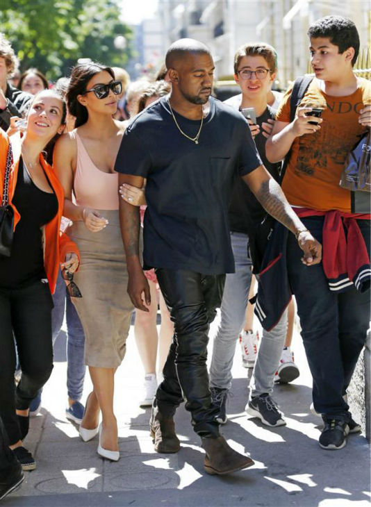 "<div class=""meta image-caption""><div class=""origin-logo origin-image ""><span></span></div><span class=""caption-text"">Kim Kardashian and Kanye West go shopping in Paris on May 19, 2014. Fans are seen following them. Many snapped selfies and other photos. (Beretta / Sims / REX / Startraksphoto.com)</span></div>"