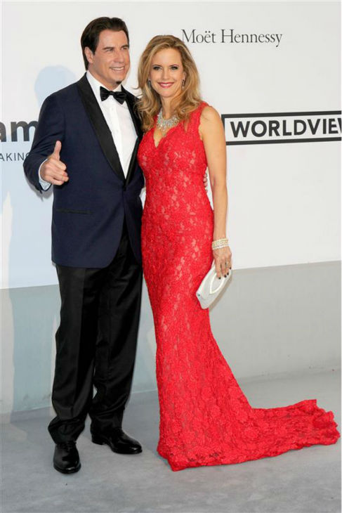 John Travolta and wife Kelly Preston attend the amfAR&#39;&#39;s 21st Cinema Against AIDS gala at the 67th Cannes Film Festival in France on May 22, 2014. There, they watched Oscar Generale, producer of the family&#39;s new animated film &#39;Gummy Bear The Movie,&#39; propose to his girlfriend, actress and model Denny Mendez <span class=meta>(Alberto Terenghi &#47; IPA &#47; Startraksphoto.com)</span>