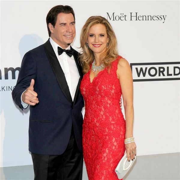 John Travolta and wife Kelly Preston attend the amfAR&#39;s 21st Cinema Against AIDS gala at the 67th Cannes Film Festival in France on May 22, 2014. There, they watched Oscar Generale, producer of the family&#39;s new animated film &#39;Gummy Bear The Movie,&#39; propose to his girlfriend, actress and model Denny Mendez <span class=meta>(Alberto Terenghi &#47; IPA &#47; Startraksphoto.com)</span>