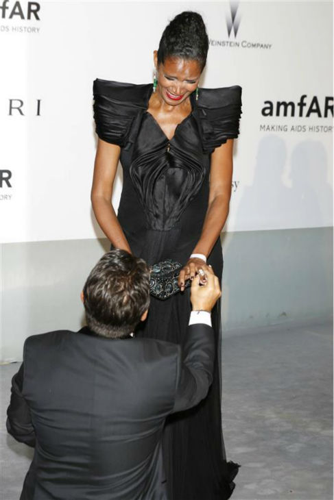 Producer Oscar Generale proposes to his girlfriend, actress and model Denny Mendez at the amfAR&#39;s 21st Cinema Against AIDS gala at the 67th Cannes Film Festival in France on May 22, 2014. John Travolta and wife Kelly Preston, who star in his animated film &#39;Gummy Bear The Movie,&#39; watched. <span class=meta>(Future Image &#47; Startraksphoto.com)</span>
