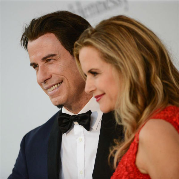 John Travolta and wife Kelly Preston attend the amfAR&#39;s 21st Cinema Against AIDS gala at the 67th Cannes Film Festival in France on May 22, 2014. There, they watched Oscar Generale, producer of the family&#39;s new animated film &#39;Gummy Bear The Movie,&#39; propose to his girlfriend, actress and model Denny Mendez. <span class=meta>(Lionel Hahn &#47; Abaca &#47; Startraksphoto.com)</span>