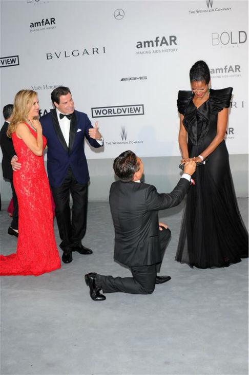 "<div class=""meta ""><span class=""caption-text "">John Travolta and wife Kelly Preston watch Oscar Generale, producer of the family's new animated film 'Gummy Bear The Movie,' propose to his girlfriend, actress and model Denny Mendez, who got emotional and accepted, at the amfAR''s 21st Cinema Against AIDS gala at the 67th Cannes Film Festival in France on May 22, 2014. (Alberto Terenghi / IPA / Startraksphoto.com)</span></div>"