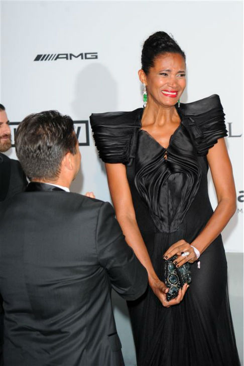 Producer Oscar Generale proposes to his girlfriend, actress and model Denny Mendez at the amfAR&#39;s 21st Cinema Against AIDS gala at the 67th Cannes Film Festival in France on May 22, 2014. John Travolta and wife Kelly Preston, who star in his animated film &#39;Gummy Bear The Movie,&#39; watched. <span class=meta>(Alberto Terenghi &#47; IPA &#47; Startraksphoto.com)</span>
