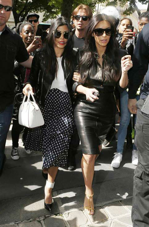 "<div class=""meta ""><span class=""caption-text "">Kourtney Kardashian and Kim Kardashian appear leaving Baby Dior in Paris on May 22, 2014. (Beretta/Sims/REX/Startraksphoto.com)</span></div>"
