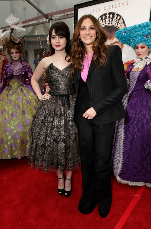 Lily Collins and Julia Roberts arrive at the premiere of &#39;Mirror Mirror&#39; at the Grauman&#39;s Chinese Theatre on March 17, 2012 in Hollywood, California. Roberts, who plays the Evil Queen, wore a Balenciaga pantsuit with a pink blouse. Collins, who plays Snow White, donned a strapless, black and gold Dolce and Gabbana tulle dress with a bell-shaped, tea-length skirt. <span class=meta>(Todd Williamson &#47; Getty Images For Relativity Media)</span>