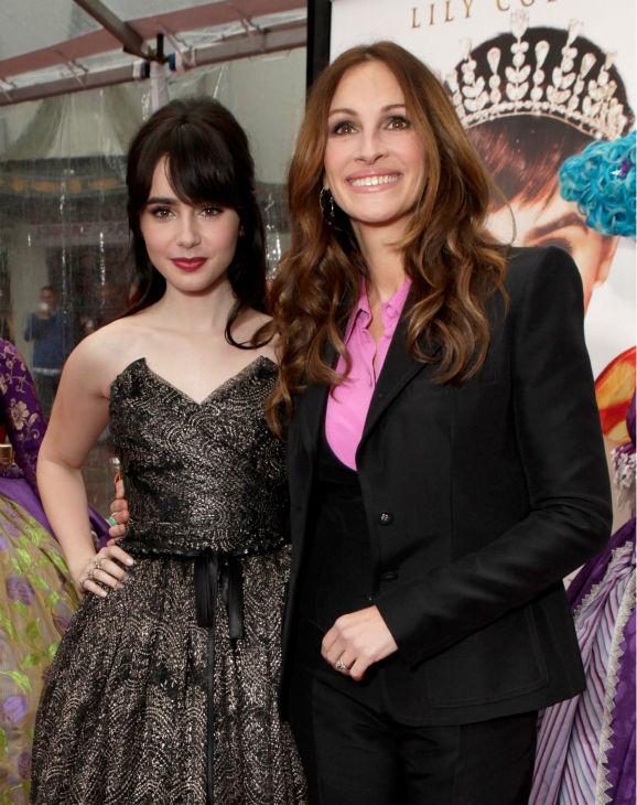 "<div class=""meta ""><span class=""caption-text "">Lily Collins and Julia Roberts arrive at the premiere of 'Mirror Mirror' at the Grauman's Chinese Theatre on March 17, 2012 in Hollywood, California. Roberts, who plays the Evil Queen, wore a Balenciaga pantsuit with a pink blouse. Collins, who plays Snow White, donned a strapless, black and gold Dolce and Gabbana tulle dress with a bell-shaped, tea-length skirt. (Todd Williamson / Getty Images For Relativity Media)</span></div>"