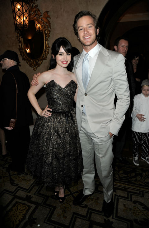 Lily Collins and actor Armie Hammer Armie Hammer attend the after party for the premiere of 'Mirror Mirror' at the Roosevelt Hotel on March 17, 2012 in Hollywood, California. Collins plays Snow White and Hammer plays Prince Charming.