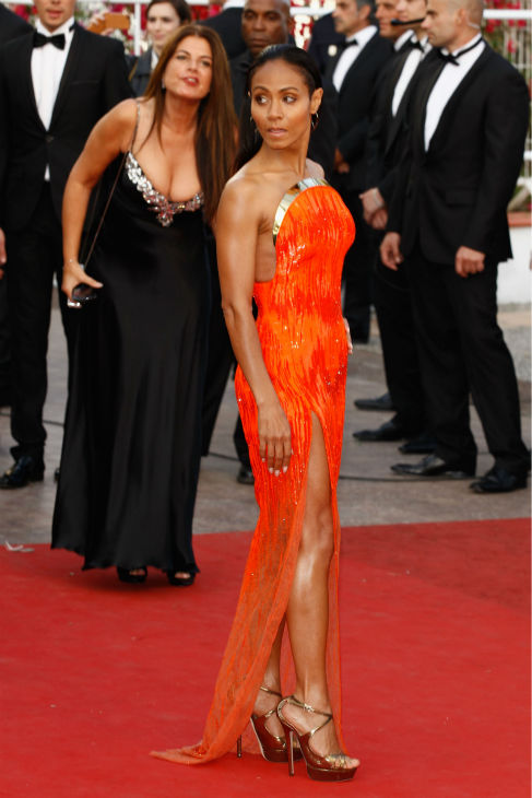 "<div class=""meta image-caption""><div class=""origin-logo origin-image ""><span></span></div><span class=""caption-text"">Jada Pinkett Smith attends the 'Madagascar 3: Europe's Most Wanted' Premiere during the 65th Annual Cannes Film Festival at Palais des Festivals on May 18, 2012 in Cannes, France.  The actress is wearing a fiery orange, strapless Atelier Versace gown with a gold metal crescent-shaped bodice and a thigh-high split. (Andreas Rentz / Getty Images for Paramount)</span></div>"