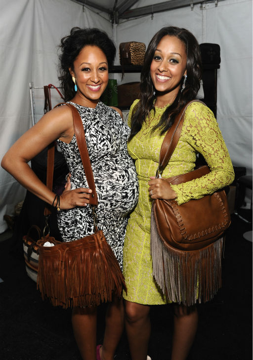 Tamera Mowry (left) and twin sister Tia appear at Backstage Creations' Ce
