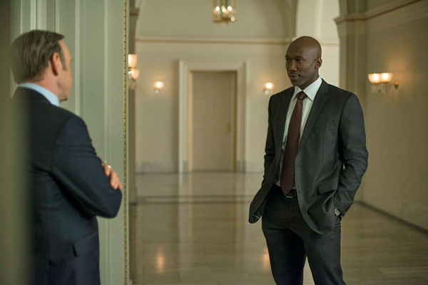 Kevin Spacey (L) and Mahershala Ali (R) appear in a scene from season 2 of Netflix's 'House of Cards.'