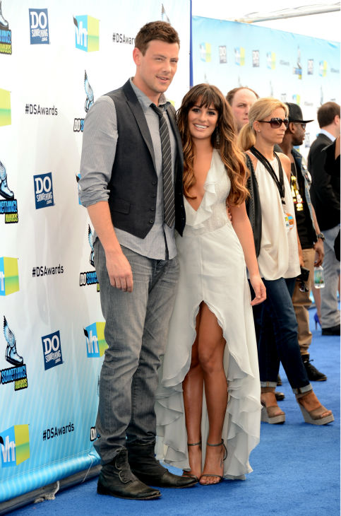 "<div class=""meta ""><span class=""caption-text "">'Glee' actress Lea Michele  and actor Cory Monteith arrive at the 2012 Do Something Awards at Barker Hangar on August 19, 2012 in Santa Monica, California. Michele is wearing an off-white Giorgio Armani gown with a plunging neckline, an open back, a central slit, and an asymmetrical, ruffled hem as well as Jenni Kayne snakeskin sandals and is carrying a metallic Fendi clutch. (Jason Merritt / Getty Images)</span></div>"
