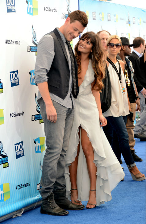 &#39;Glee&#39; actress Lea Michele  and actor Cory Monteith arrive at the 2012 Do Something Awards at Barker Hangar on Aug. 19, 2012 in Santa Monica, California. Michele is wearing an off-white Giorgio Armani gown with a plunging neckline, an open back, a central slit, and an asymmetrical, ruffled hem as well as Jenni Kayne snakeskin sandals and is carrying a metallic Fendi clutch. <span class=meta>(Jason Merritt &#47; Getty Images)</span>