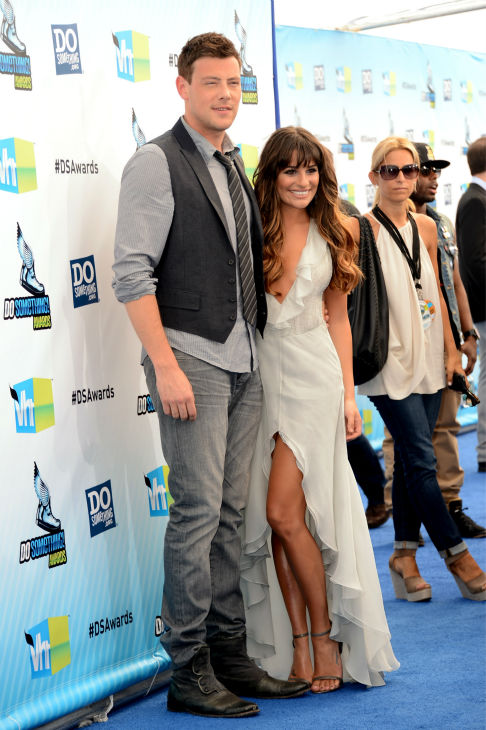 &#39;Glee&#39; actress Lea Michele  and actor Cory Monteith arrive at the 2012 Do Something Awards at Barker Hangar on August 19, 2012 in Santa Monica, California. Michele is wearing an off-white Giorgio Armani gown with a plunging neckline, an open back, a central slit, and an asymmetrical, ruffled hem as well as Jenni Kayne snakeskin sandals and is carrying a metallic Fendi clutch. <span class=meta>(Jason Merritt &#47; Getty Images)</span>