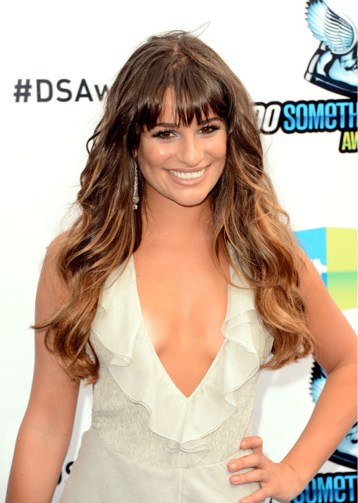 "<div class=""meta image-caption""><div class=""origin-logo origin-image ""><span></span></div><span class=""caption-text"">'Glee' actress Lea Michele arrives at the 2012 Do Something Awards at Barker Hangar on August 19, 2012 in Santa Monica, California. She is wearing an off-white Giorgio Armani gown with a plunging neckline, an open back, a central slit, and an asymmetrical, ruffled hem as well as Jenni Kayne snakeskin sandals and is carrying a metallic Fendi clutch. (Jason Merritt / Getty Images)</span></div>"