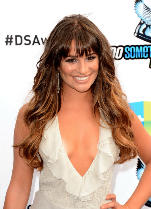 &#39;Glee&#39; actress Lea Michele arrives at the 2012 Do Something Awards at Barker Hangar on August 19, 2012 in Santa Monica, California. She is wearing an off-white Giorgio Armani gown with a plunging neckline, an open back, a central slit, and an asymmetrical, ruffled hem as well as Jenni Kayne snakeskin sandals and is carrying a metallic Fendi clutch. <span class=meta>(Jason Merritt &#47; Getty Images)</span>