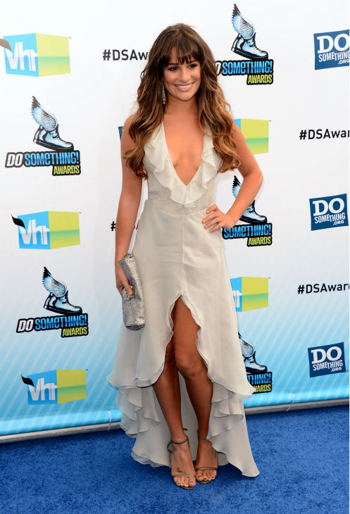"<div class=""meta ""><span class=""caption-text "">'Glee' actress Lea Michele arrives at the 2012 Do Something Awards at Barker Hangar on August 19, 2012 in Santa Monica, California. She is wearing an off-white Giorgio Armani gown with a plunging neckline, an open back, a central slit, and an asymmetrical, ruffled hem as well as Jenni Kayne snakeskin sandals and is carrying a metallic Fendi clutch. (Jason Merritt / Getty Images)</span></div>"