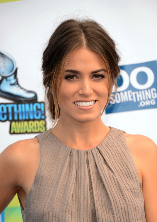"<div class=""meta ""><span class=""caption-text "">'Twilight' actress Nikki Reed arrives at the 2012 Do Something Awards at Barker Hangar on August 19, 2012 in Santa Monica, California. She is wearing a Lela Rose Resort 2013 textured and pleated dress with a knee-high slit and sparkling Jimmy Choo 'Sierra' sandals and is carrying a Lena Erziak 'Charles' clutch. (Jason Merritt / Getty Images)</span></div>"