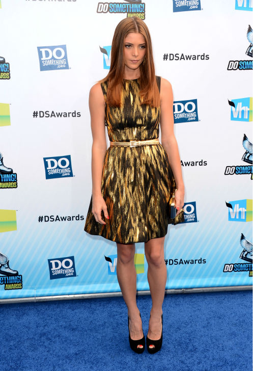 &#39;Twilight&#39; actress Ashley Greene arrives at the 2012 Do Something Awards at Barker Hangar on August 19, 2012 in Santa Monica, California. She is wearing a gold and black ikat jacquard Michael Kors Resort 2013 dress and black Giuseppe Zanotti peep-toe heels and is carrying a black-and-gold Roger Vivier &#39;Boite de Nuit&#39; clutch. <span class=meta>(Jason Merritt &#47; Getty Images)</span>