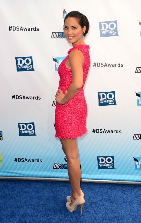 Olivia Munn, who stars in the HBO show &#39;The Newsroom,&#39; arrives at the 2012 Do Something Awards at Barker Hangar on August 19, 2012 in Santa Monica, California. She is wearing a hot pink, patterned Alice &#43; Olivia mini-dress and nude Sole Society pumps. <span class=meta>(Jason Merritt &#47; Getty Images)</span>