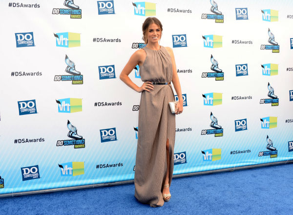 &#39;Twilight&#39; actress Nikki Reed arrives at the 2012 Do Something Awards at Barker Hangar on August 19, 2012 in Santa Monica, California. She is wearing a Lela Rose Resort 2013 textured and pleated dress with a knee-high slit and sparkling Jimmy Choo &#39;Sierra&#39; sandals and is carrying a Lena Erziak &#39;Charles&#39; clutch. <span class=meta>(Jason Merritt &#47; Getty Images)</span>