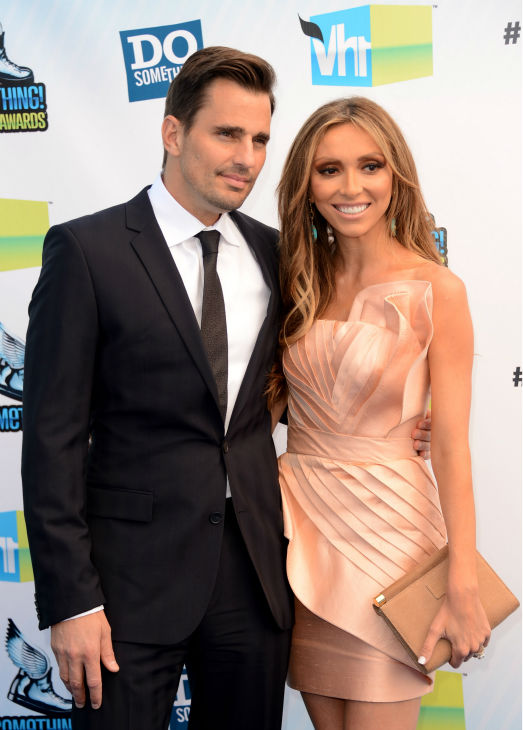 E! host Giuliana Rancic and husband Bill Rancic arrive at the 2012 Do Something Awards at Barker Hangar on August 19, 2012 in Santa Monica, California. <span class=meta>(Jason Merritt &#47; Getty Images)</span>