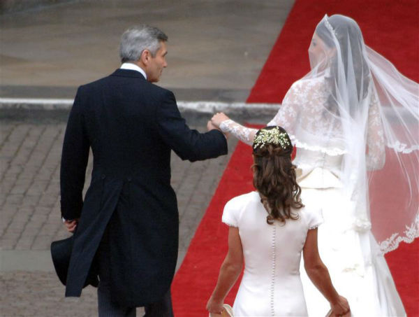 Pippa Middleton holds her sister Kate Middleton&#39;s train at her Royal Wedding to Prince William at Westminster Abbey in London on April 29, 2011. Pictured on the left: Their father, Michael Middleton. Pippa became famous due to her a cowl-neck, body-hugging, ivory bridesmaid gown by Sarah Burton at Alexander McQueen. <span class=meta>(AMP &#47; Startraksphoto.com)</span>