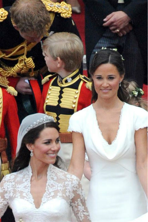 Pippa Middleton holds her sister Kate Middleton&#39;s train at her Royal Wedding to Prince William at Westminster Abbey in London on April 29, 2011. Pictured on the left: Their father, Michael Middleton. Pippa became famous due to her a cowl-neck, body-hugging, ivory bridesmaid gown by Sarah Burton at Alexander McQueen. <span class=meta>(Cisotti-Diddia &#47; Startraksphoto.com)</span>